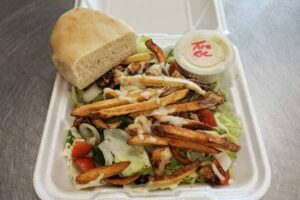 salad, fresh bread, and fries to go